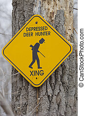 Depressed Deer Hunter Crossing - A yellow and black sign...
