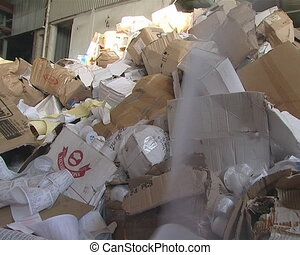 Cashier check roll rolled out Huge heap of carton and paper...
