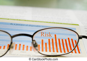 glasses and stock chart showing risk