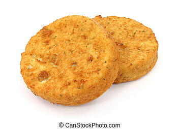 Fish cakes - Two fresh fish cakes on a white background.