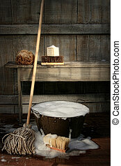 Old wash bucket with mop and brushes Vintage look
