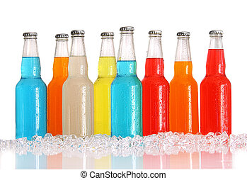 Bottles of multi-color drinks with ice on white background