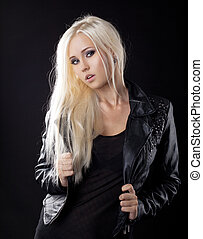Beauty blond girl in leather jacket