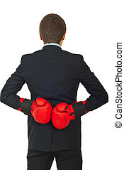 Back of business man with boxing gloves