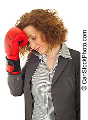Profile of loser business woman holding hand in boxing glove...