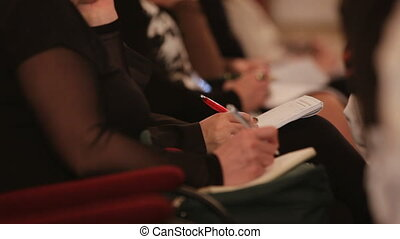 Lectures - Person records the information on the sheet of...