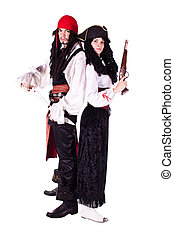 Pirate man and woman - A man and a woman dressed as a...