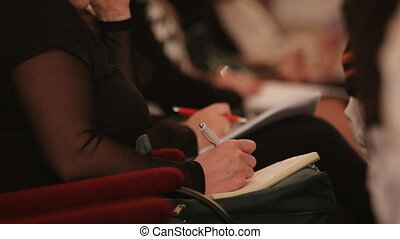 Interesting seminar - Person records the information on the...