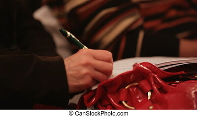 Carefully record the lecture - Person records the...