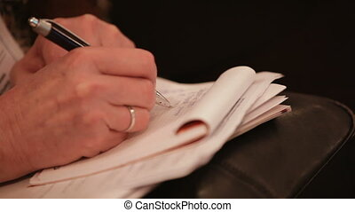 Write notes - Man preparing to write information into a...