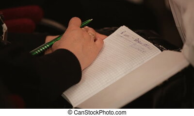 Applause for lectures - Man preparing to write information...