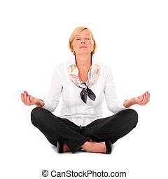 Yoga - A picture of a mature woman practising yoga over...