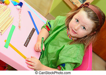 happy smiling kid drawing at home or school kindergarden or...