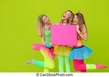 happy party or fancy dress girls with blank board