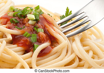 Spaghetti with tomato sauce close up