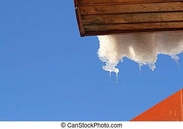 Roof with melting hanging icicles and snow - Icicles and...
