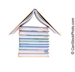 Book House - House made from few new books on white...