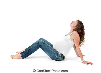 Pregnant woman doing gymnastic exercises on isolated white...