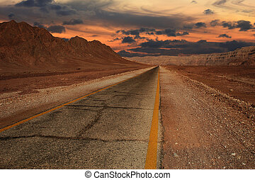 Sunset in desert. - Beautiful sunset over hills and...