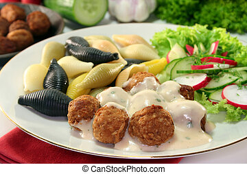 Swedish meatballs with noodles and radish-cucumber salad
