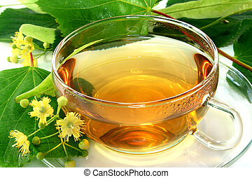Linden flower tea - a cup of lime blossom tea with fresh...