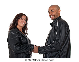 Multicultural couple holding hands and smiling