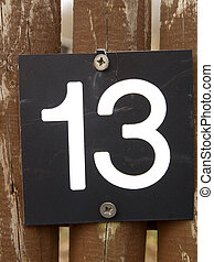 fence with the number 13