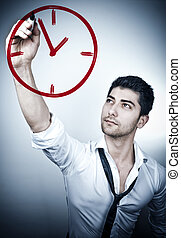 Its time - Young business man drawing a clock on a glass...
