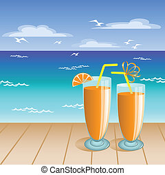 Juice on the beach - two glasses of orange drink on the...