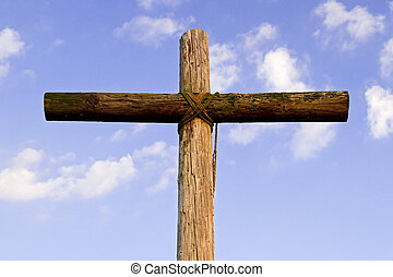 Old Rugged Cross and Blue Sky - An old, rugged, wooden cross...