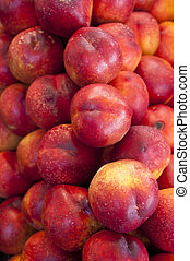 Red nectarines on display in a market