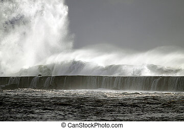 Tsunami - Big storm wave against harbor of Vila do Conde,...