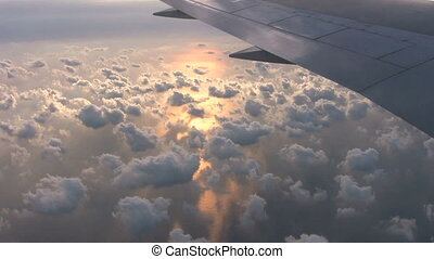 Pretty Sunset From Airplane - Clouds float above the ocean...