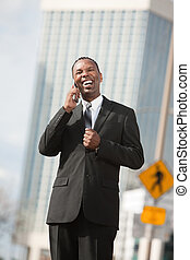 Excited Businessman On Phone Call