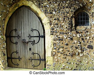 An Old Door and Tiny Barred Window - An ancient arched...