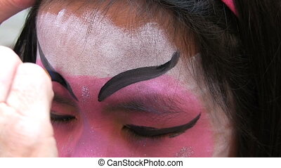Japanese Face Painting-Eyebrows - A pretty Asian girl has...