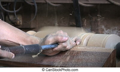 Kitchen Table Leg On Lathe - A man shapes a table leg for a...