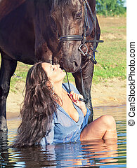 pretty women with horse in water