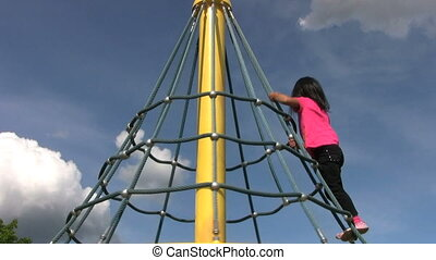 Little Asian Girl Climbs A Carousel - A cute little Thai...