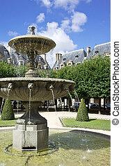 Place des Vosges - Fountain at the Place des Vosges, the...