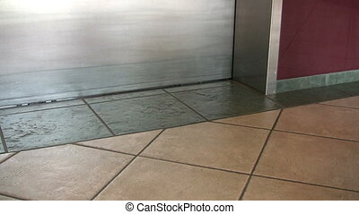 Man Walking Into Elevator - A man walking into an elevator....