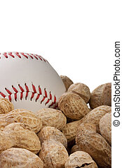 Nuts Peanuts on a table together with a baseball ball