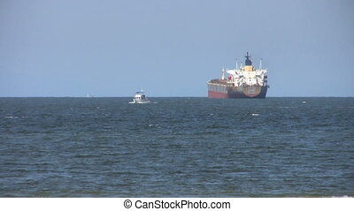 Ocean Scene With Big Ship And Boat - A cool shot of a...
