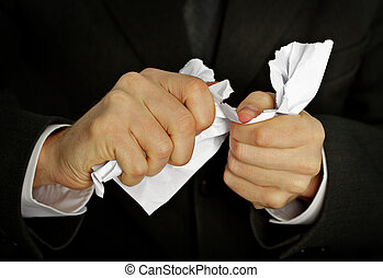 Businessman hands furiously tormenting document close up