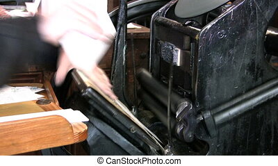 Old Style Printing Press Stopping - An old style printing...