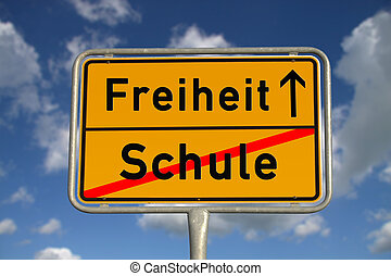 German road sign school and freedom with blue sky and white...