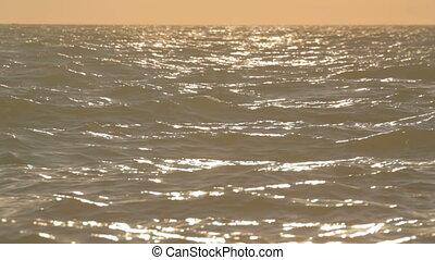 Sun glare reflecting on the ripplin