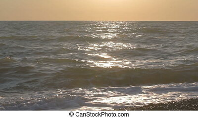Sea waves with splashing away water