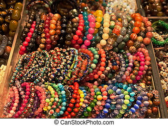 Colourful bracelets on Market stand - Assortment of...