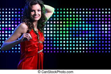 Beautiful young woman dancing in t